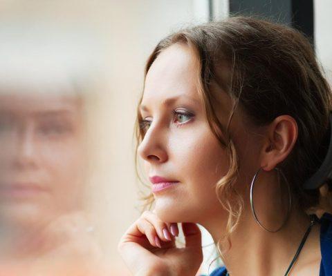 Truama Therapy Wichita Ks Woman Alone Looking Out Window